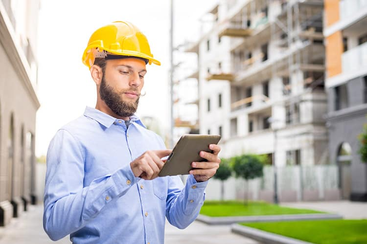 Construction worker using a tablet to access SecureCore from the cloud